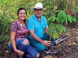 Mariela and Lalo Loor plant seedlings